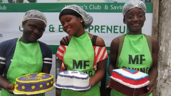 Three pastry trainees pose with decorated cakes at Mineke Foundation