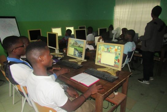 Teenagers during computer lessons at Mineke Foundation