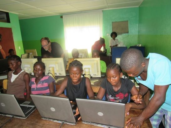 Teenagers in computer class at Mineke Foundation
