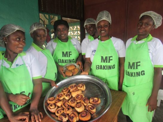 Pastry trainees show off cinnamon rolls at Mineke Foundation