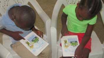 Two children reading at Mineke Foundation